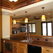 Traditional Basement by Thelen Total Construction