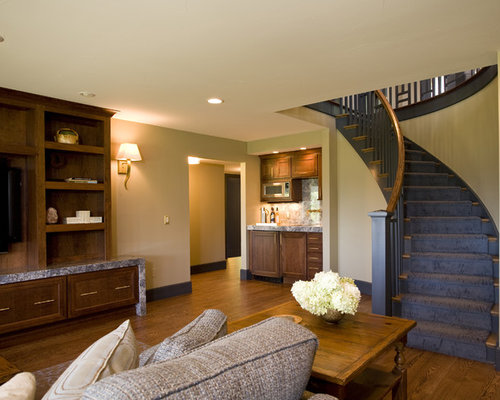 Example Of A Classic Basement Design In New York With Beige Walls, Medium  Tone Hardwood