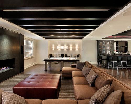 basement interior design ideas. Large Trendy Dark Wood Floor And Brown Basement Photo In Chicago With White Walls, Interior Design Ideas