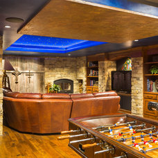 Rustic Basement by CHC Creative Remodeling