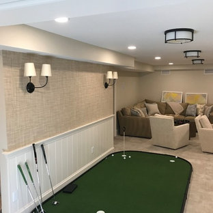This is an example of a mid-sized traditional fully buried basement in Boston with beige walls, carpet, no fireplace and grey floor.