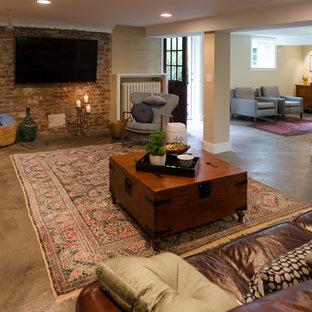 Aménagement d'un sous-sol craftsman donnant sur l'extérieur et de taille moyenne avec un mur beige, béton au sol, un sol gris, une cheminée standard et un manteau de cheminée en carrelage.