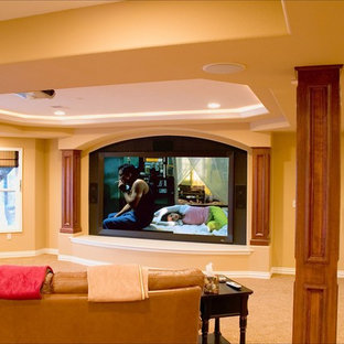 Inspiration for a large timeless walk-out carpeted basement remodel in Denver with yellow walls, a corner fireplace and a stone fireplace