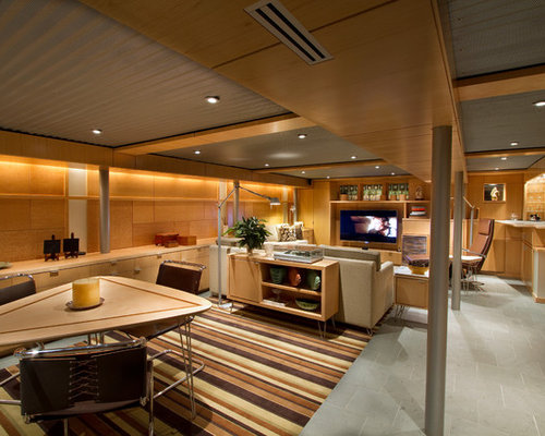 midsized midcentury modern lookout ceramic floor basement idea in with brown