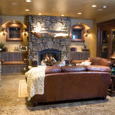 Rustic Basement by DesignWorks Development