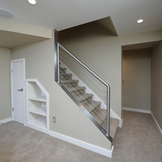 Contemporary Basement by DeHaan Remodeling Specialists, Inc.