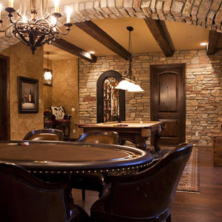 This is an example of a large mediterranean walk-out basement in Detroit with brown walls, dark hardwood flooring and brown floors.