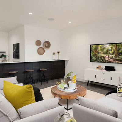 Trendy underground brown floor basement photo in Seattle with white walls and no fireplace