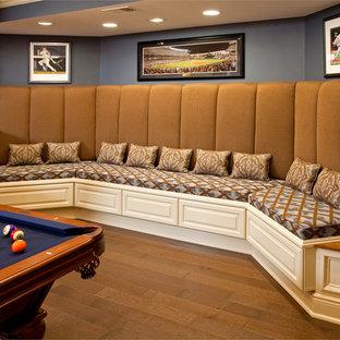 Basement - large traditional walk-out medium tone wood floor basement idea in Philadelphia with blue walls