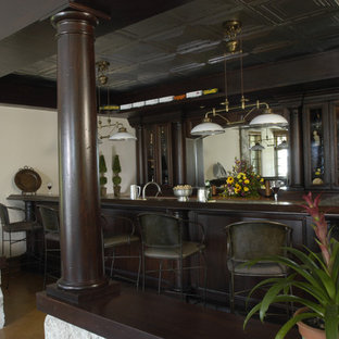 Mahogany Wet Bar with Tin Ceiling, Copper Countertop and Stained Concrete Floors