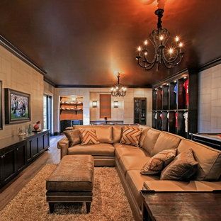 Inspiration for a timeless walk-out dark wood floor and brown floor basement remodel in Tampa with gray walls and no fireplace