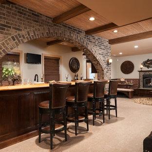 Inspiration för en stor vintage källare utan fönster, med beige väggar, en standard öppen spis, en spiselkrans i tegelsten, klinkergolv i keramik och beiget golv
