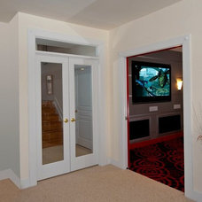 Traditional Basement by Synergy Design & Construction
