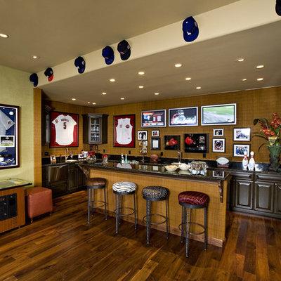 Tuscan dark wood floor basement photo in Phoenix with green walls and a bar