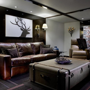 Example of a mountain style underground carpeted and black floor basement design in Other