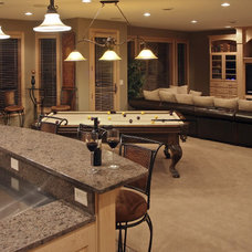 Contemporary Basement by Minnesota Valley Construction, Inc.