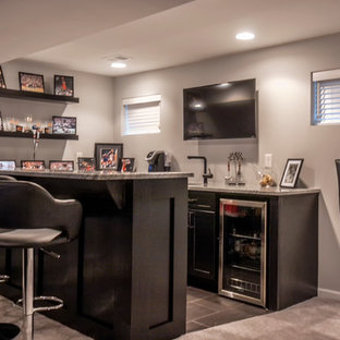 Inspiration for a mid-sized modern underground carpeted basement remodel in Denver with gray walls