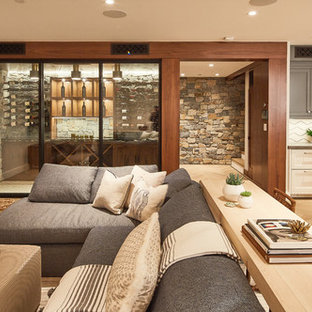 Basement - transitional light wood floor and beige floor basement idea in Los Angeles with beige walls