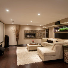 Contemporary Basement by Realstone Systems