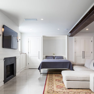 Example of a mid-sized trendy walk-out concrete floor and gray floor basement design in Seattle with white walls, a standard fireplace and a stone fireplace