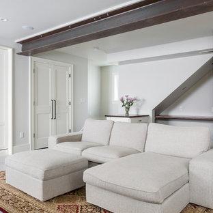 Idee per una taverna design di medie dimensioni con sbocco, pareti bianche, pavimento in cemento e pavimento bianco
