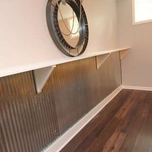 Example of a large minimalist underground basement design in Grand Rapids with gray walls
