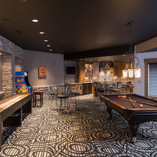 Example of a trendy underground carpeted and multicolored floor basement game room design in Cleveland with no fireplace and gray walls