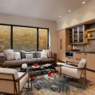 Example of a mountain style look-out light wood floor basement design in Denver with beige walls and no fireplace