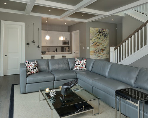 Traditional underground gray floor basement idea in Toronto with gray walls