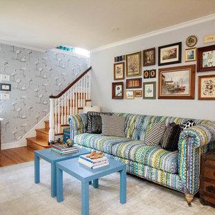 Basement - eclectic medium tone wood floor and brown floor basement idea in Philadelphia with gray walls