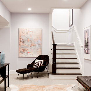 Basement - transitional underground carpeted and gray floor basement idea in New York with white walls and no fireplace