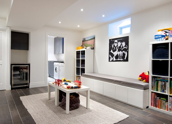 Contemporary Basement by Andrew Snow Photography