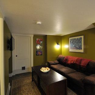 Cette image montre un petit sous-sol craftsman enterré avec un mur vert, béton au sol et aucune cheminée.