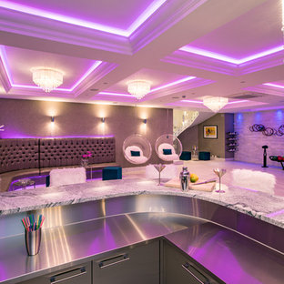This is an example of a contemporary basement in Buckinghamshire with multi-coloured walls.