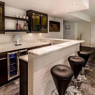 Basement - large modern walk-out black floor basement idea in Richmond with beige walls