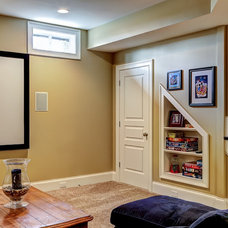 Traditional Basement by The Ramage Company