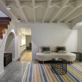 Inspiration for a mediterranean fully buried basement in Sydney with white walls, concrete floors and grey floor.