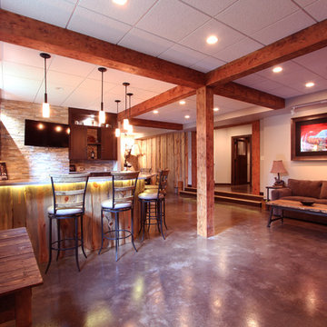 Open concept basement with lots of natural texture