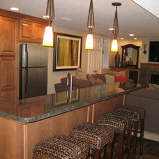 Traditional Basement by Kitchens by Design
