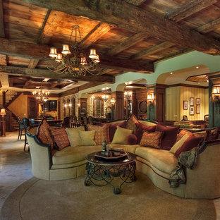 Ispirazione per un'ampia taverna stile rurale con sbocco, pareti verdi e pavimento con piastrelle in ceramica