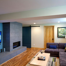 Contemporary Basement by TreHus Architects+Interior Designers+Builders