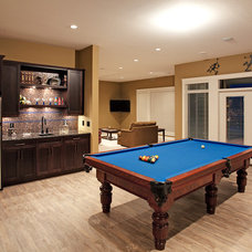 Traditional Basement by Norelco Cabinets Ltd