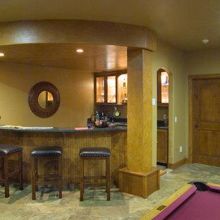 Idées déco pour un très grand sous-sol classique enterré avec un mur marron, moquette, une cheminée standard, un manteau de cheminée en pierre et un sol beige.
