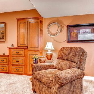 Exemple d'un grand sous-sol chic donnant sur l'extérieur avec un mur beige, moquette, une cheminée double-face, un manteau de cheminée en pierre et un sol beige.