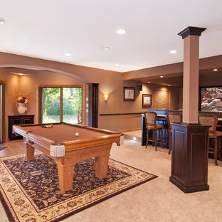 Basement - large traditional walk-out carpeted basement idea in Minneapolis with brown walls