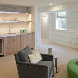 Design ideas for a beach style look-out basement in Grand Rapids with white walls, carpet, no fireplace and beige floor.