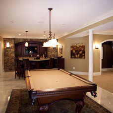 Traditional Basement by Total Living Construction