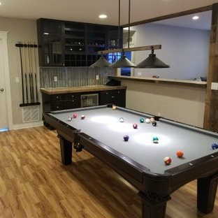 Inspiration for a mid-sized rustic basement remodel in Denver