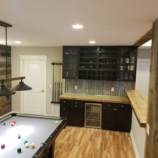 Example of a mid-sized mountain style basement design in Denver