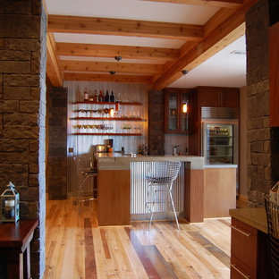 Mid-sized mountain style walk-out medium tone wood floor basement photo in Kansas City with brown walls and no fireplace